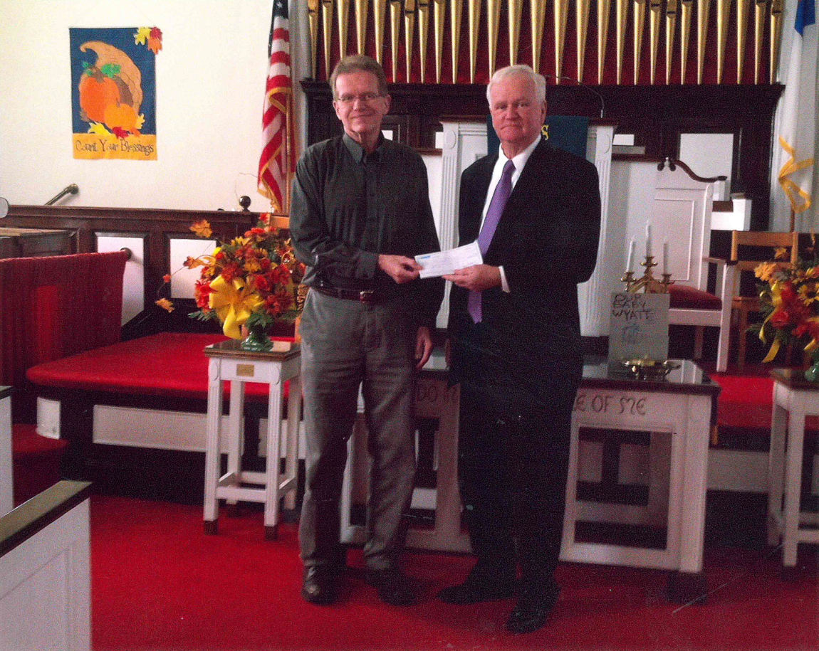 Pastor Jeffrey Receiving a Donation from Amboy Bank to help fix our parking lot.
